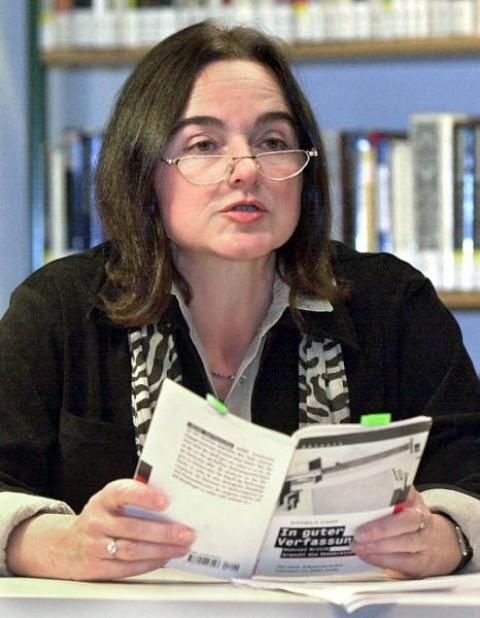 """Author Daniela Dahn is shown during a reading from her polemical pamphlet """"In guter Verfassung"""" [""""In Good Constitution""""] (1999) on November 1, 2000, in Rostock's city library. The author, who was born in Berlin in 1949, was already famous for her earlier books Wir bleiben hier oder Wem gehört der Osten [We're Staying Here or Who Owns the East] (1994), Westwärts und nicht vergessen [Westwards and Don't Forget] (1996), and Vertreibung ins Paradies [Expulsion into Paradise] (1998). After…"""