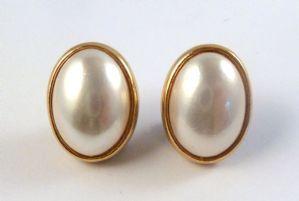 Vintage pair of faux pearl cabochon bezel set earrings, by vintage designer Sphinx.