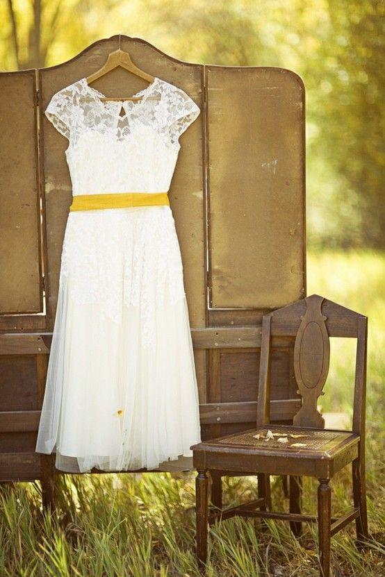 White dress with yellow sash
