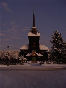 """Åmot kirke, Åmot (Norway), inaugurated in 1902.    Designed by Henrik Bull, as is the funeral chapel (inaugurated in 1915) next door to the church. The church is locally referred to as """"Tømmerkatedralen"""" (i.e., The lumber cathedral) by some."""