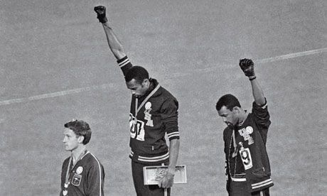 Top 10 Inspiring Olympic Stories - Black Power Salute  In 1968, Americans John Carlos and Tommie Smith won the bronze and gold medals in the 200-meter dash. Their medal ceremony would have been rather uneventful had Carlos and Smith not raised black-gloved fists when the Star-Spangled Banner came to play. Australian Peter Norman, the silver medalist, wore an Olympic Project for Human Rights badge in solidarity with the two athletes....Click Image to Read More.