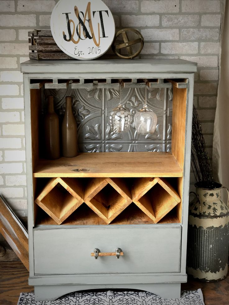 This was a 4 drawer tall dresser we upcycled into a Wine Bar
