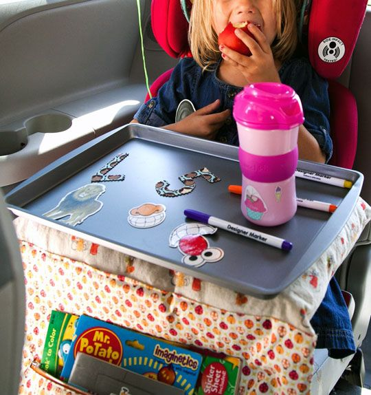 Car awesomeness - magnet/snack tray, pockets and a pillow that fold up into its own travel bag