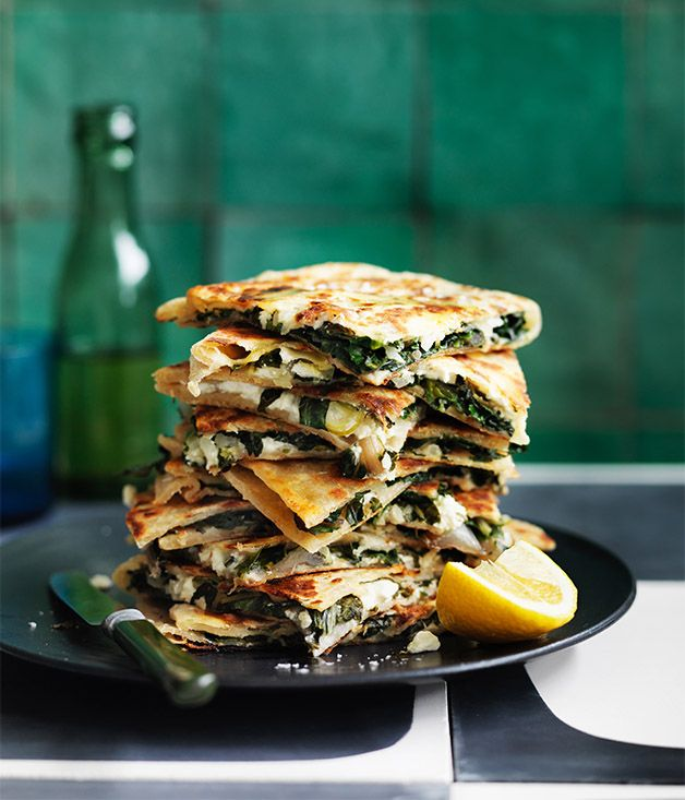 Feta and greens gozleme recipe - Combine flours in a bowl with 1 tsp salt and make a well in the centre. Add yoghurt, oil and 260ml water to well and mix to form a rough dough.