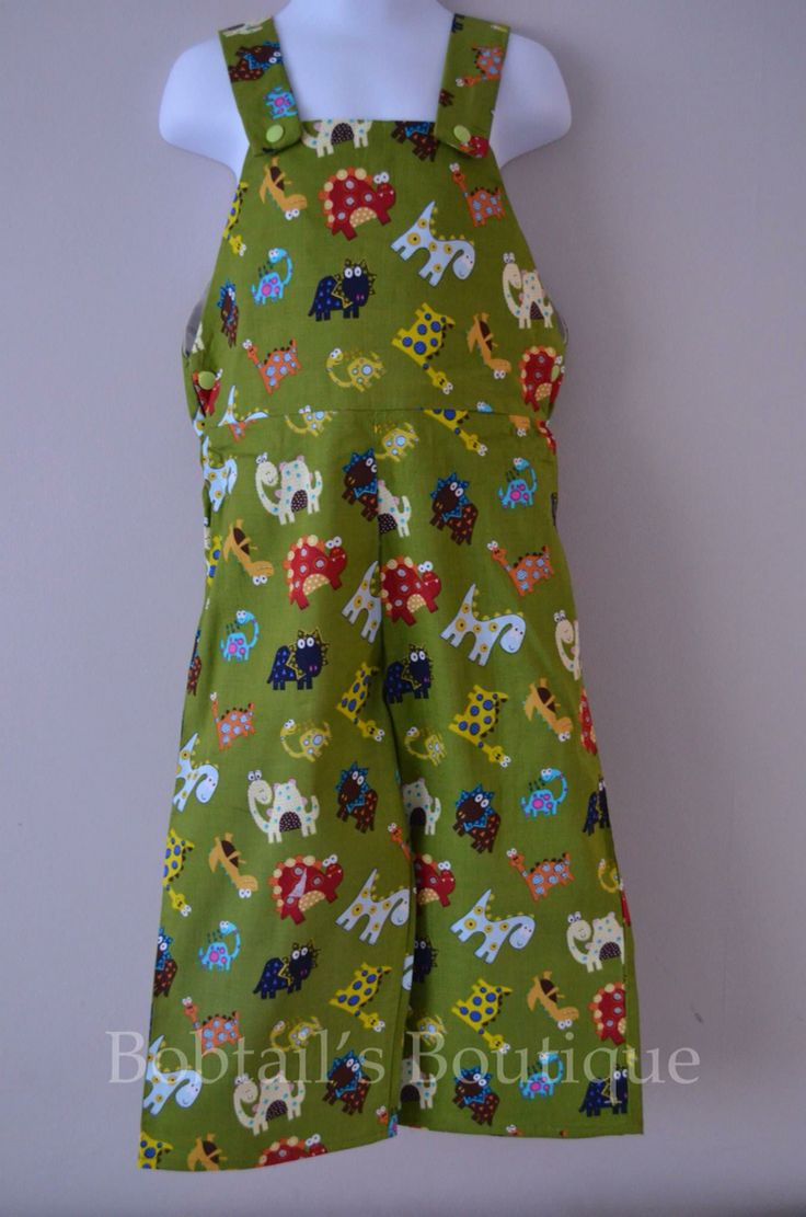 Dinosaur Dungarees size 3 years with a popper shoulder fastening.