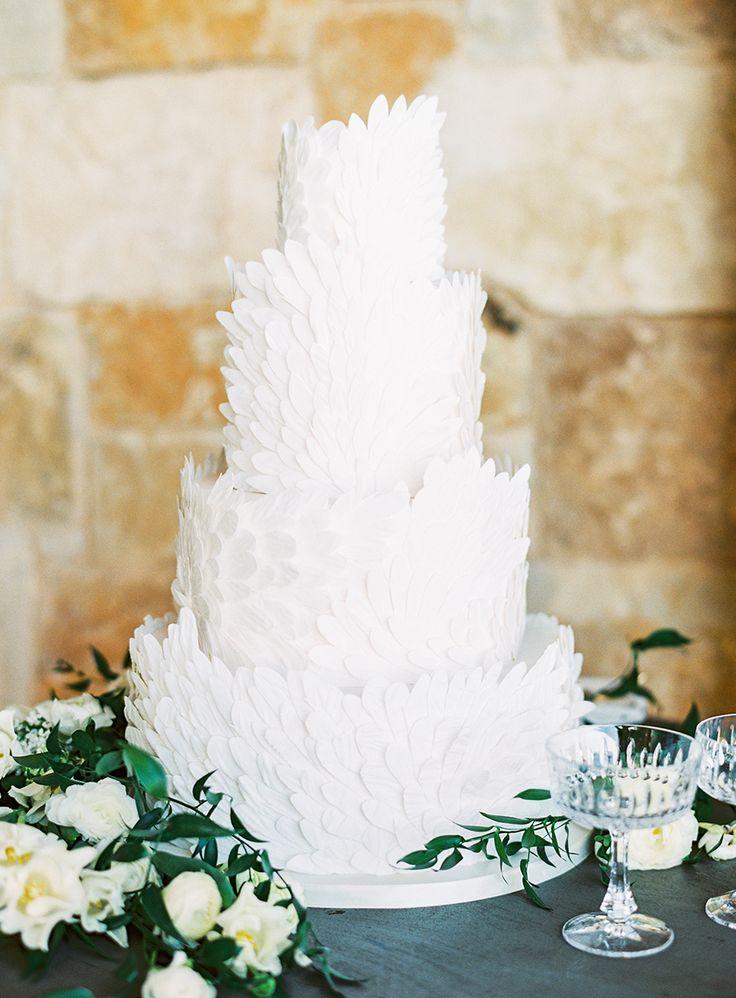 four tier white wedding cake | Photography: Sally Pinera