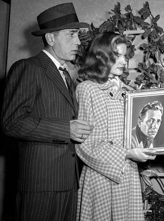 — Lauren Bacall and Humphrey Bogart being presented...