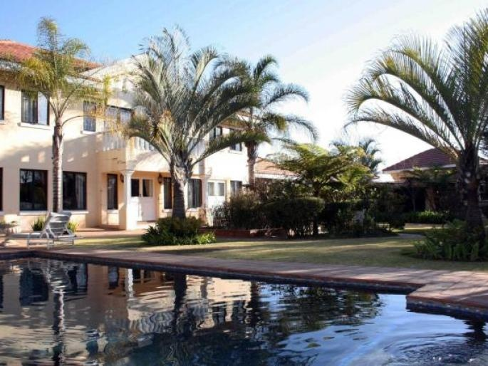 Traditional, double-storey English manor country home with a cottage, as well as a separate business, located on a 4,000 sqm stand in central Bryanston.