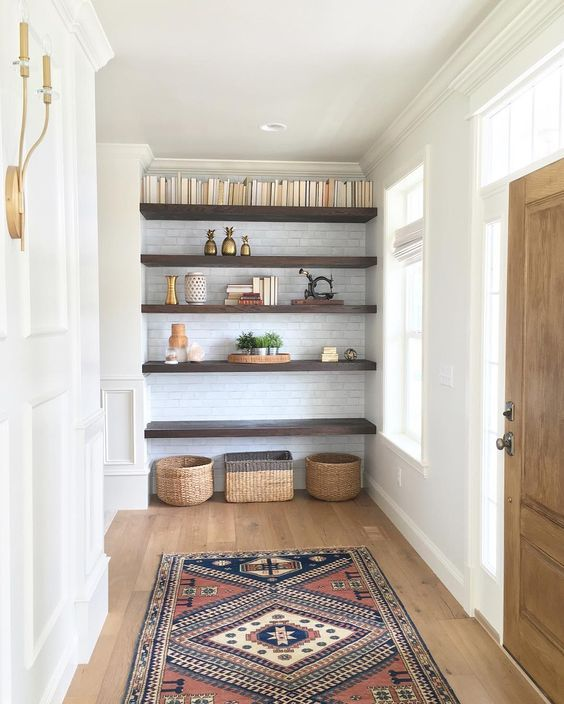 Built-in wooden shelves on subway tile