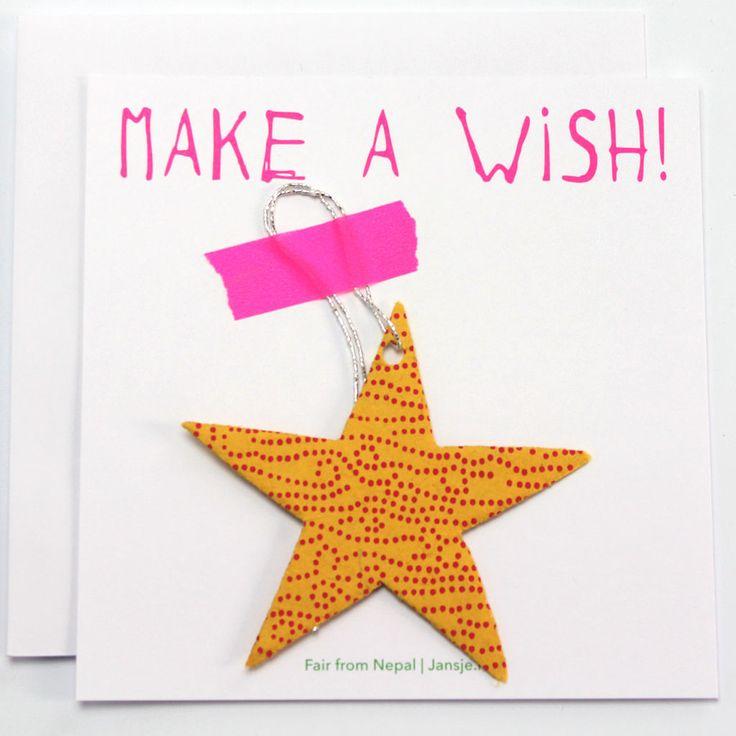 Make a wish!  Deze serie feestelijke kaarten zijn een eigen Jansje design!   De kaarten met feestelijke hanger is gelijk een lief klein cadeautje. De hanger in de vorm van een ster is voorzien van een zilver draadje en om op te hangen. Alle kaarten zijn voorzien van een leuke tekst.  De hanger is gemaakt van papier van een Lokta plant. De plant wordt tot pulp gemalen, de pulp wordt geschept in een zeef om op te drogen tot papier. Daarna worden de verschillende vormen voor de hangers…