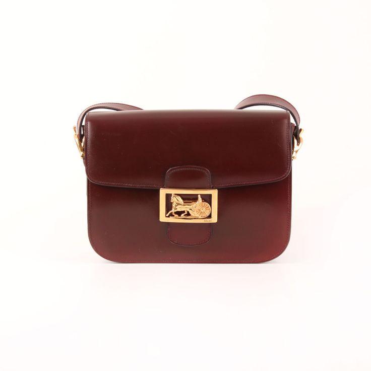 """Céline Vintage Flap Bag with """"calèche"""" clasp in burgundy."""