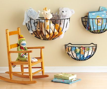 15 Cool DIY Toy Storage Ideas   Shelterness: wall mount garden planter baskets. Spray paint to match any decor.