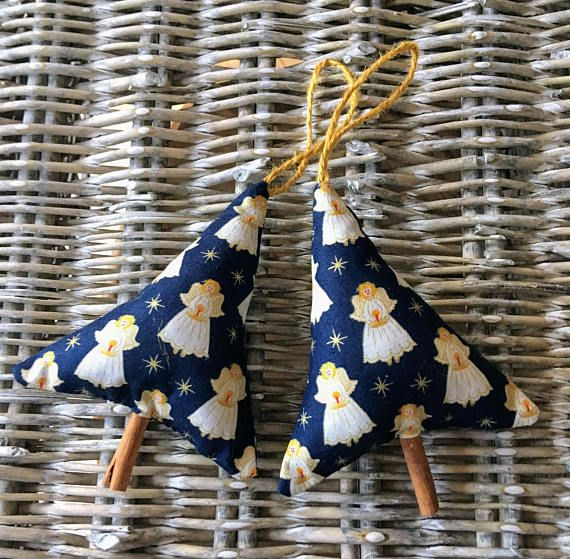 Christmas tree decoration in angel fabric with cinnamon stick