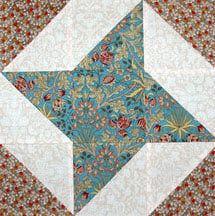 Use my free quilt block pattern to stitch a variation of the Friendship Star quilt block, an easy patchwork design with triangles in its corners.