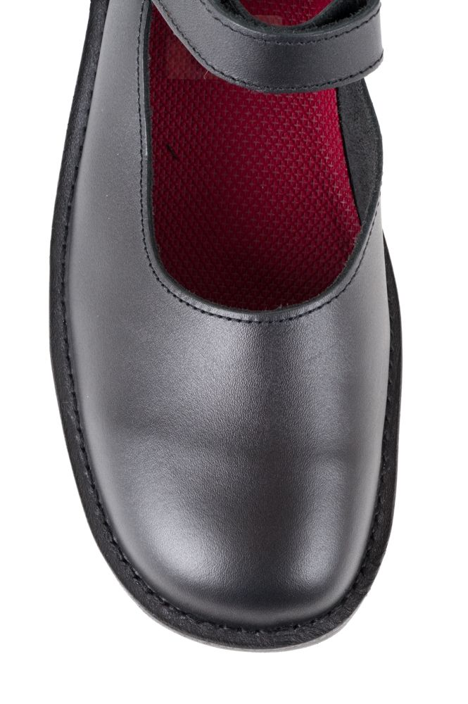 Black leather Mary-Jane school shoe. High back height and deep fit to protect andsupport the foot. Removable insole. Can beworn withown orthotics. Adjustable velcro ankle strap. Leather upper. Rubber grip tread sole. Made in Dunedin, New Zealand.