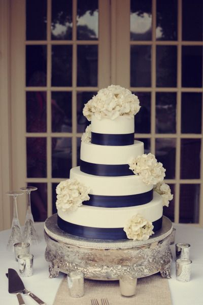 Elegant navy and white four-tier wedding cake