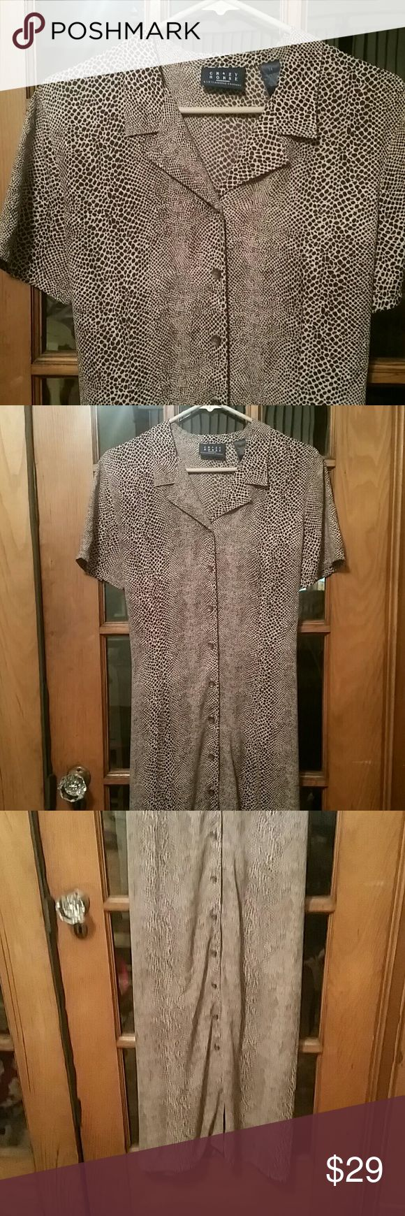 """Crazy Horse Animal Print Dress Very pretty button down, collared short sleeve animal print  maxi dress. This is a long dress that buttons all the way down the front  and ties around the waist in the back. Size 14, EUC,  no flaws.  Length approx 53 3/4"""", armpit to armpit approx 20"""". Color,  brown and beige. Smoke Free Home Dresses Maxi"""