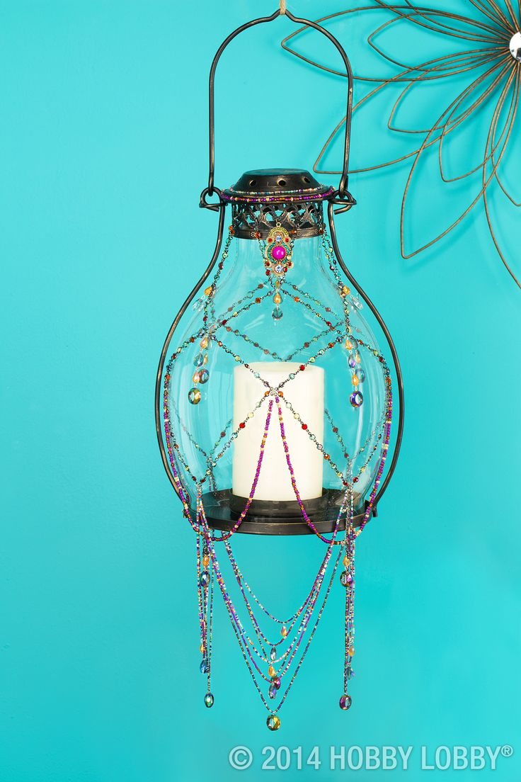Decorating with lanterns is an easy way to transition into each new season. Add beaded wire jewelry for a bohemian flair to these glass lanterns.