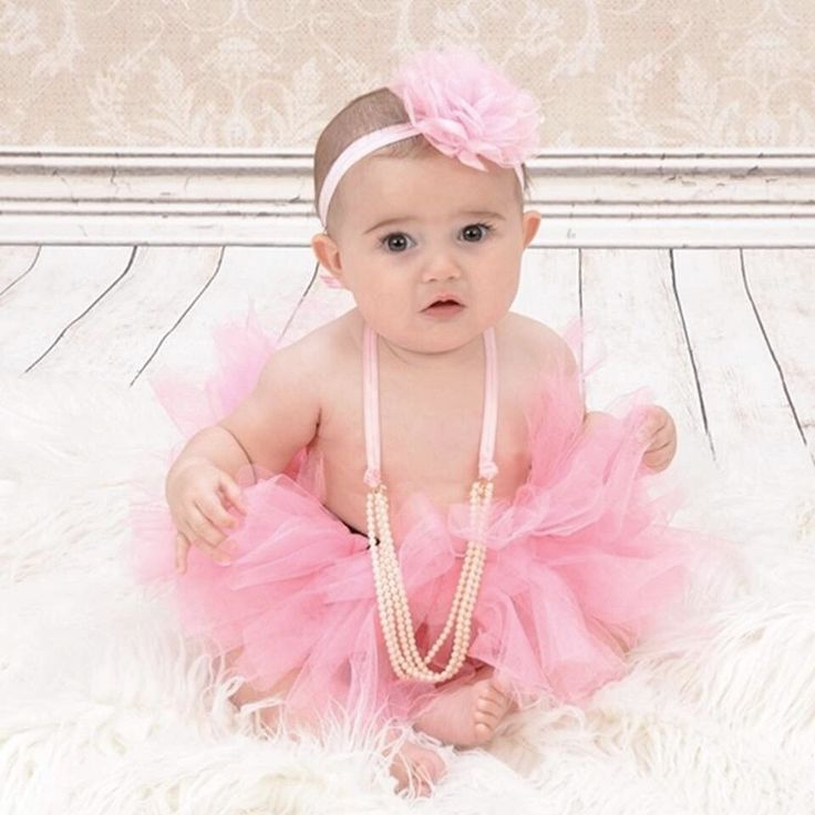 Baby girl six month photos 6 month pictures. Pink tutu headband pearls
