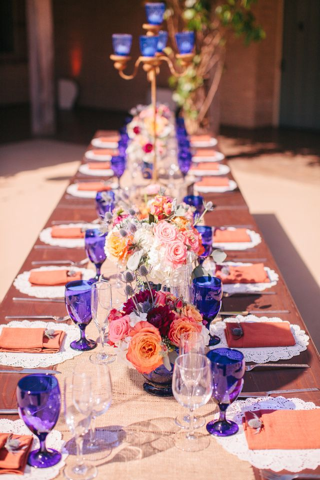 Spanish style wedding table - love the colors with the cobalt blue glass, flowers by www.stellabloomdesigns.com and photo by I Heart My Groom