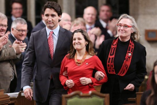 Liberal Leader Justin Trudeau (left) along with Liberal MP Carolyn Bennett (right) escort recently elected Liberal MP Chrystia Freeland, of the Toronto centre riding, into the House of Commons in Ottawa, Monday January 27, 2014. THE CANADIAN PRESS/Fred Chartrand