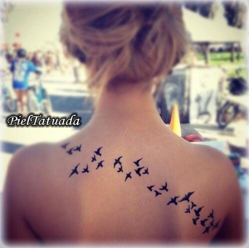 Aves en la espalda.