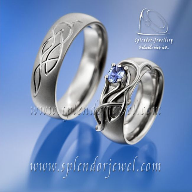 These wedding bands show a very good example of design that match each other but still has uniqueness of female and male wedding ring. Personally, I love the blue sapphire gemstone in the middle of the fine white gold ornament - it gives very noble look. Check more wedding bands at www.splendorjewel.com