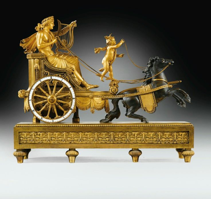 A LARGE PATINATED AND GILT-BRONZE MANTEL CLOCK BY SIMON DEVERBERIE, CONSULAT, CIRCA 1800.  LOT SOLD. 225,000 EUR.