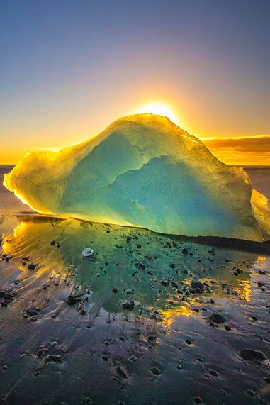 Sun through the ice - what a plethora of colors, it looks like its own little planet!