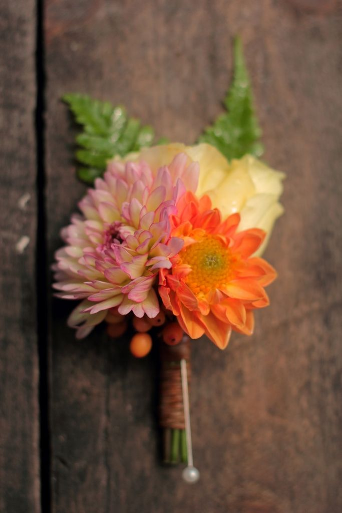 Pin-on corsage featuring dahlias