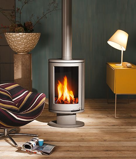 images of rooms with modern wood stoves | Solea compact rotating stove - burn wood or gas - from Wanders ...