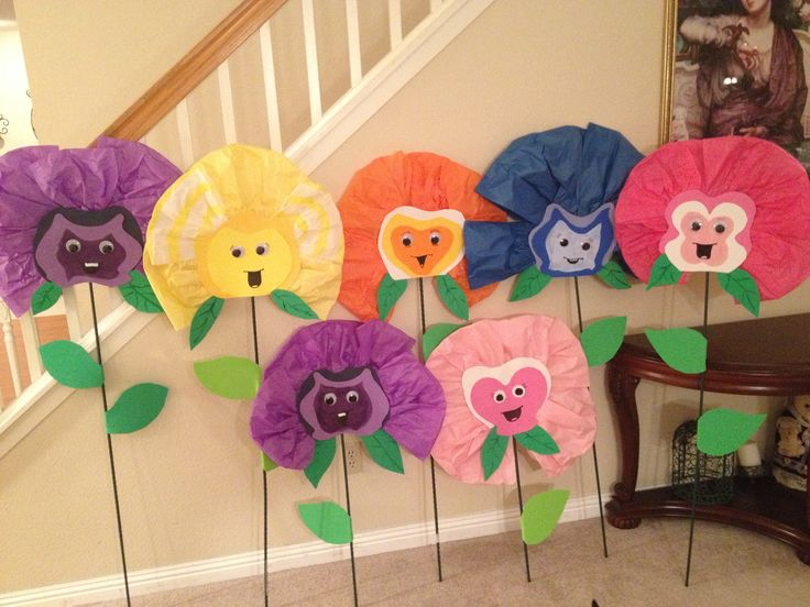Singing flowers - Alice in Wonderland party  These are a little cheesy. I think I would put a lot more detail into them! But it would be a super fun idea!