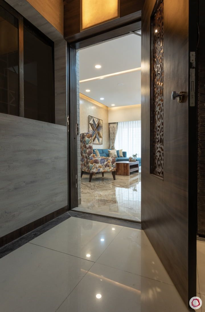 Compact 2bhk That Embodies The Spirit Of Mumbai Door Design Garage Door Design Front Door Design