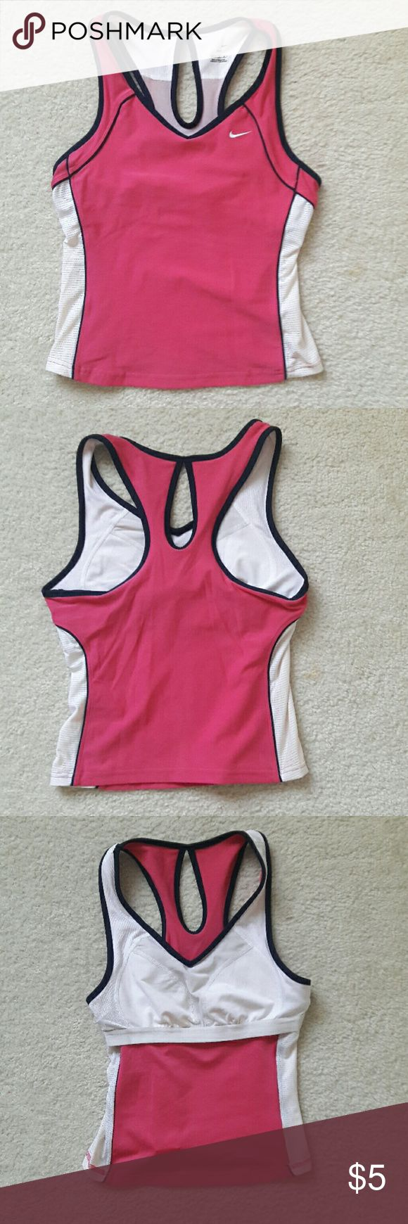 Nike Dri-Fit athletic tank top with build in bra This is almost brand new Nike Dri-Fit athletic tank top with a build in bra. Will fit small and medium ladies. Smoke and pet free home. Will ship immediately. Nike Tops Tank Tops