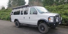 Project Gallery Archives - Van Haus with Aluminess front and rear bumper, roof rack, and nerf bars