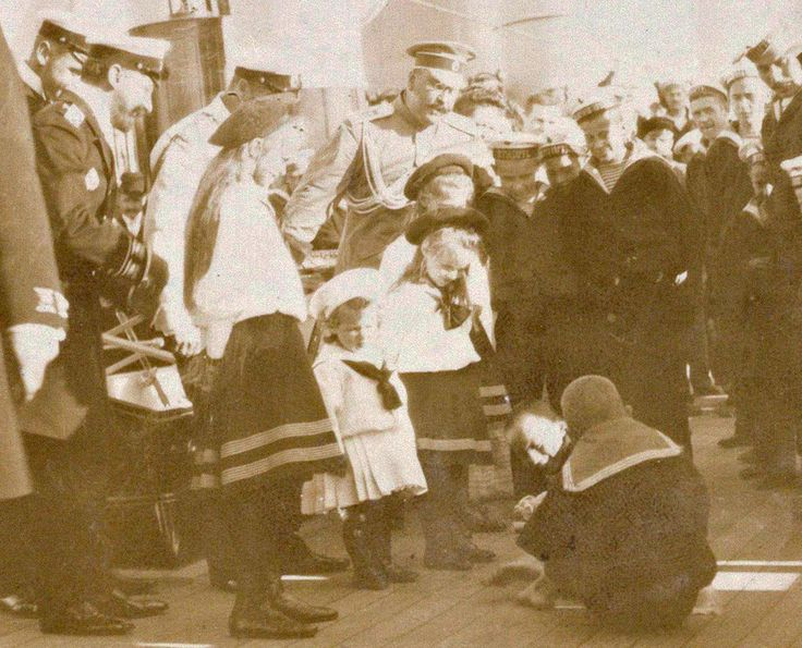 Grand Duchesses Olga, Anastasia and Maria and Tsarevich Alexei with officers.
