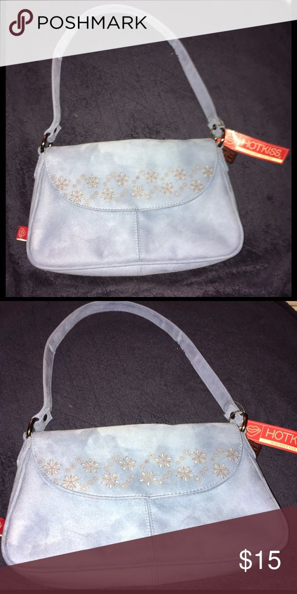 Blue Purse From HotKiss NWT This is a cute bag in a faded blue color. By HotKiss and its new, never been used. Hot Kiss Bags Shoulder Bags