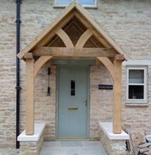 oak partitions porch.  I like the side stone walls