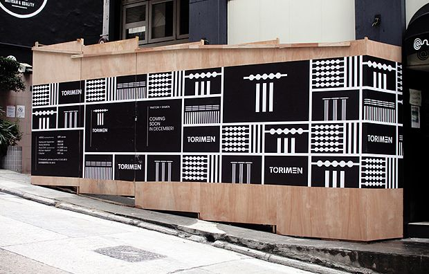 Construction hoardings are large boards that are built for a temporary period of time, to shield renovations that are happening behind the hoarding. These boards will eventually be pulled down to unveil the storefront or new building once it is ready to be opened to the public. Until