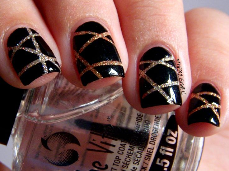 Striping tape nail art, black over gold glitter base