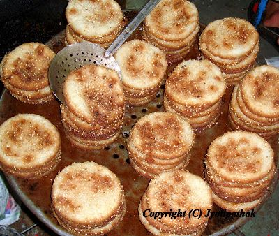 Anarsaa - अनर्सा - (Poppy Seed Rice Flour Patties) The traditional sweet is freshly fried until lightly browned and stacked up neatly. It is kept this way until all the extra clarified butter is drained from the patties, before moving into a decorative platter. Anarsaa is eaten during festivals, family celebrations, and simply as a mid-afternoon snacks.