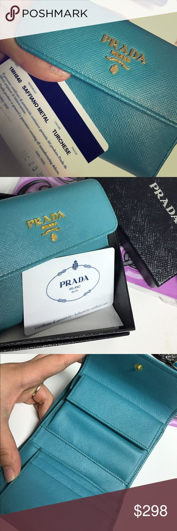 Tiffany blue Authentic Prada Wallet Tiffany blue authentic Prada Wallet. Comes with card of authenticity and box. Slight discoloration on corner of wallet. PRICE FIRM! Prada Bags Wallets