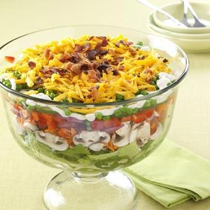 Favorite Layered Salad Recipe -This salad offers the best that summer produce has to offer, and it looks so beautiful layered in a glass bowl. It's almost too pretty to dig into…almost! And it's perfect for potlucks. —Jodi Anderson, Overbrook, Kansas