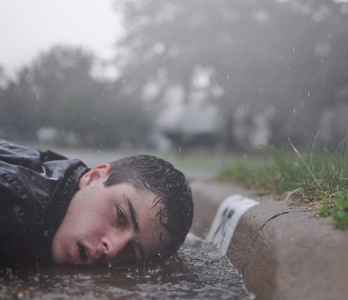 He lay on the ground, his body numb. The life flowed out of him like the water around him. Slowly he was swept into the never ending current of death.