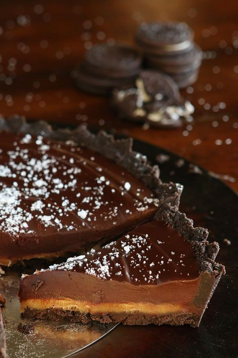 Dark Chocolate Salted Caramel Pie with an Oreo Cookie Crust. Only 5 ingredients!! This is the perfect dessert for company, because you can make it the night before and it's still just as good the next day -- and you're not messing up the kitchen!
