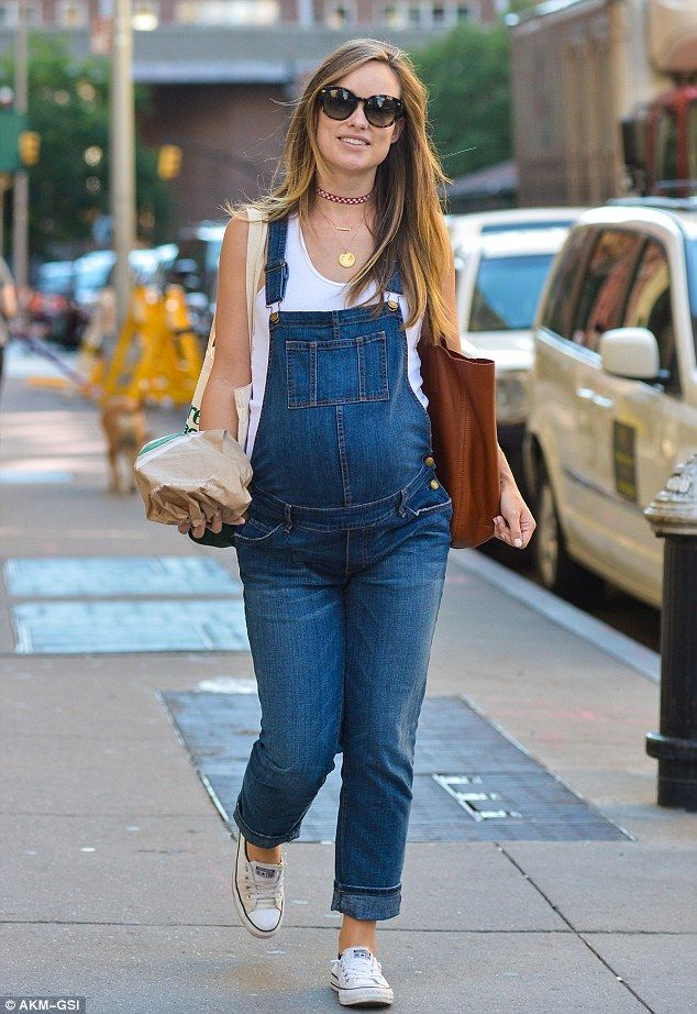 Eating for two! Pregnant Olivia Wilde donned dark blue dungarees during a solo Manhattan stroll for take-out on Friday