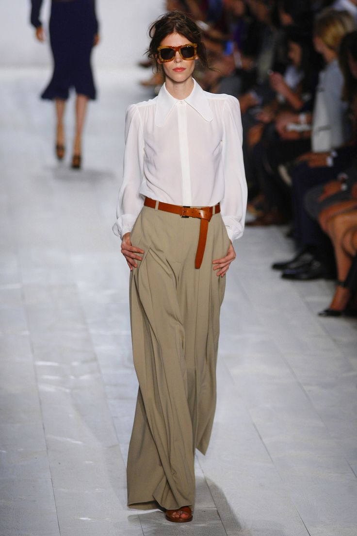 We love this simple ensemble -- the palazzo pants add just enough pizazz. via StyleList