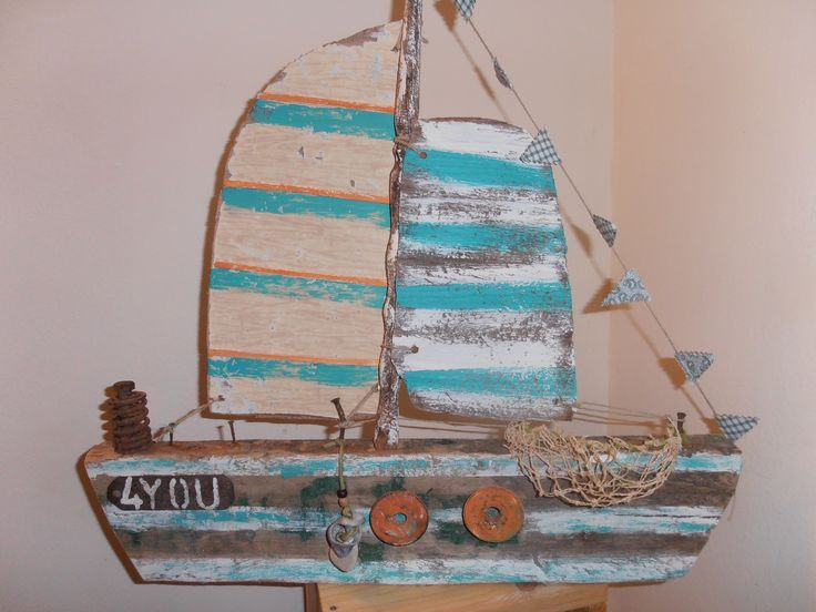 driftwood boat, this one is called 4 You. Sea side art design by Philippa Komercharo.