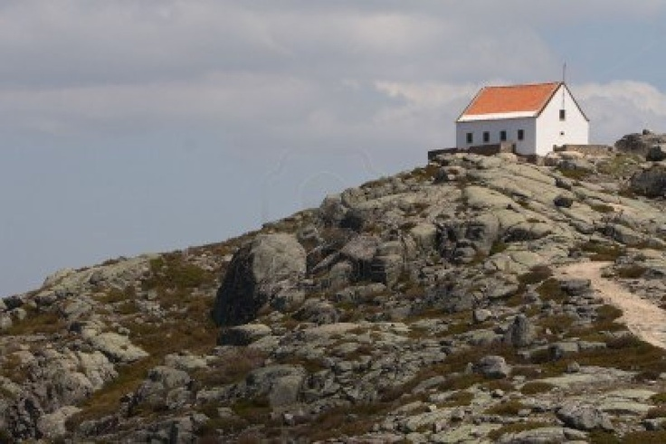 House on the top of the mountain. Picture taken in Serra de Estrela mountains in Portugal Stock Photo