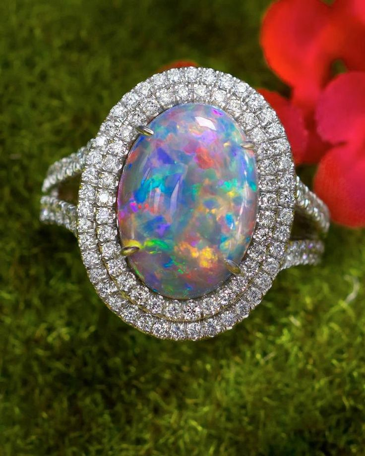 Harlequin opal engagement ring